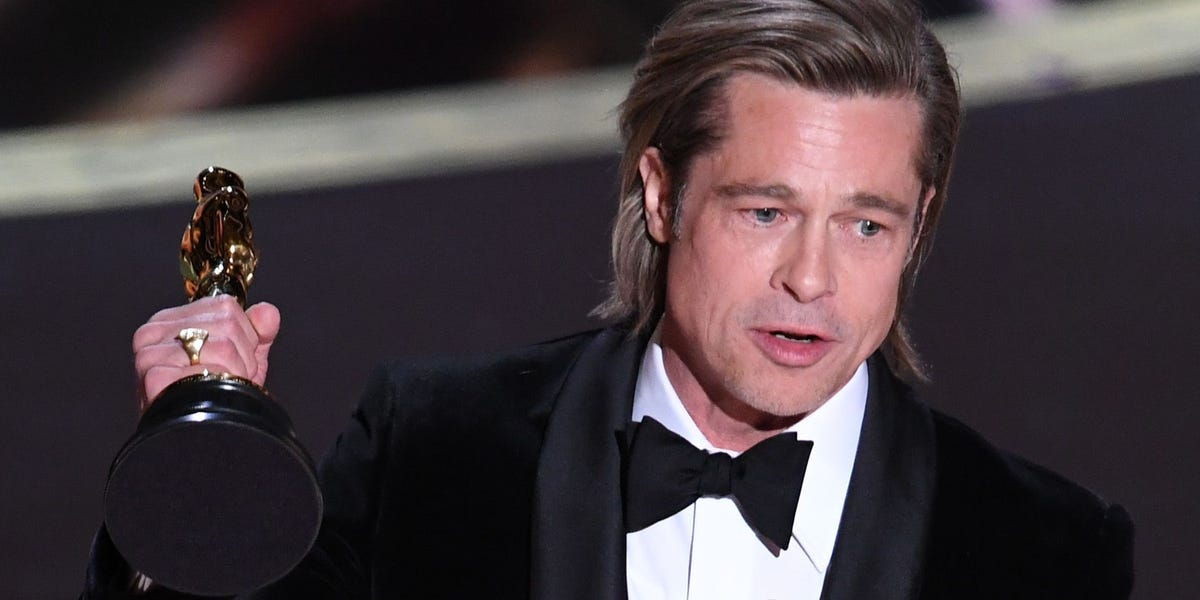 Brad Pitt joked in his Oscars speech that he would ride Leonardo DiCaprio's coattails any day: 'The view's fantastic'